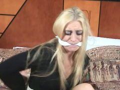 Platinum blonde girl Keli Anderson getting tied up on the hotel room
