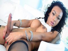 Black shemale Nicole Starr strips, masturbates and cums